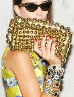 Gold clutch, red tips.