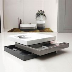 From white to dark gray, a first glance, this three toned table makes a stunning statement. But it gets better. These high-gloss stacked trays fan out not only for dramatic effect, but also for tucking away things you don't want out all the time.