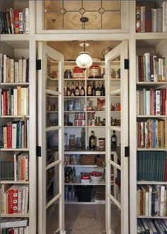 LOVE this pantry...the glass doors and transom, the cookbooks
