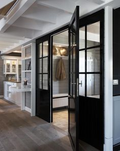 mud room with black lacquered doors