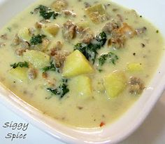 zuppa tuscana soup!    •4 slices bacon, diced   •1 lb ground hot Italian sausage   •1 large yellow onion, diced   •4 cloves garlic, minced   •4 cups (32 oz) chicken stock   •3 cups russet potatoes, cubed   •3/4 tsp sea salt   •1/4 tsp freshly ground black pepper   •2 cups kale, washed and cut into bite size pieces   •1 cup heavy whipping cream   •Parmesan cheese, grated, to taste