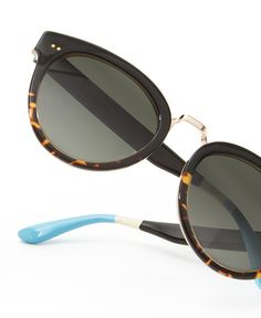 Extreme detail on the TOMS Yvette sunglasses - a cat-eye style with a black and tortoise frame.