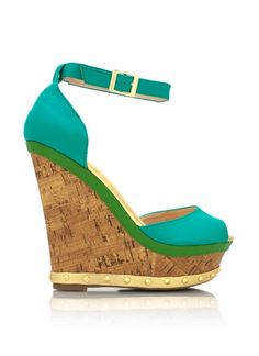 Metal spikes adorn the bottom of these peep-toe wedges.