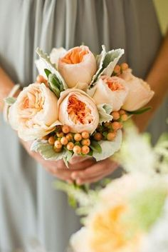 DESCRIPTION: Peach garden roses pair with soft lambs ear for a sweet, romantic bouquet. Image: Grey Likes Weddings