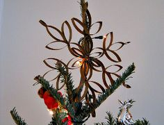 You won't believe the easily available material used to create this gorgeous Golden Tree Topper. Hint: it's totally free and you can find it in your home.