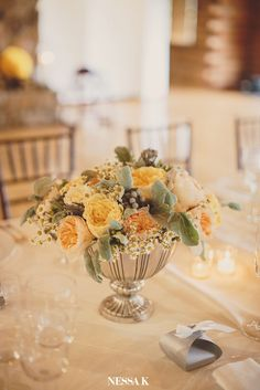 Rent a pewter bowl for wedding centerpiece  Seneca Creek floral designs by Elegance & Simplicity, INc.
