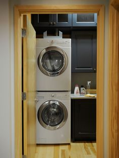 i adore an organized laundry room with cabinet space and counter top to fold!