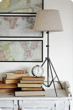 framed maps and unusual lamp.