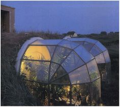 ridiculously cool underground home with unique greenhouses attached