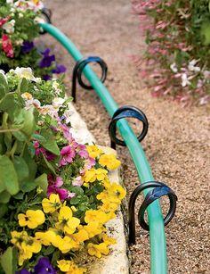 Keeps hose off plants!