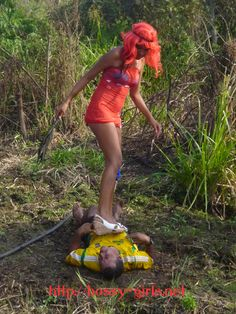 "From Femdom video ""Mud Femdom Story"" Ms. Gzandra kindly stomping Mr. Fernadel into the mud"