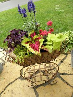 summer flowers, garden planters, garden ideas, blue flowers, bee, flower baskets, wire baskets, plant containers, bungalow