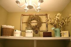 love the simplicity yet purposeful decor of this shelf above a washer/dryer