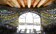 """""""stained glass"""" wall of recycled bottles and cement."""