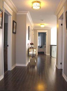 BM Revere Pewter paint, dark wood floors, white trim. Love it!!!!! Wall Colors, Floor, Light Fixtures, Grey Wall, Gray Walls, Paint Colors, Hous, Hallway, Benjamin Moore