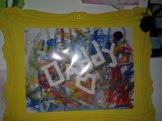 i taped the word daddy and a heart and let my 2 year old paint all over it, when the paint dried i pulled off the tape.