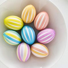 Pastel Striped Eggs      To create this look, cut a variety of colors of Japanese washi tape into thin lengthwise strips. Attach strips to the egg, allowing the tape to overlap at the top and bottom.
