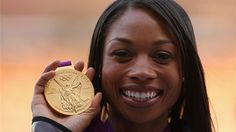 Gold medallist Allyson Felix of the United States poses on the podium