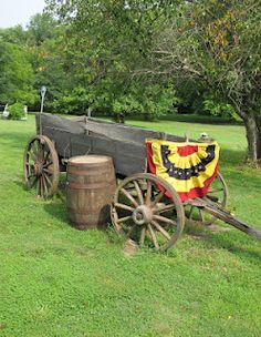 Prims...old wagon  barrel...Americana bunting.