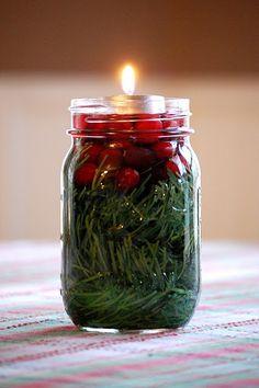 Simple and Pretty ~ mason jar, greenery, cranberries, water, tea light ~ simple Christmas table centerpiece, big impact!