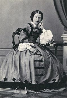 1860's Dress with wonderfully creative dark trim on skirt and bodice, very full voile type undersleeves and white lace collar.