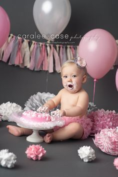 Smash that cake! Caralee Case Photography #caraleecasephotography #cakesmash #birthdayphotos #oneyearold #photography #children #pink #gray
