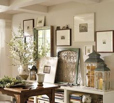 I am in LOVE with this entire wall and book case. It's just FABULOUS! The books in the lantern, the mirror with the deep frame, the little pics on top of the other photo. So much depth and texture!