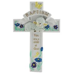 """Baptism Cross,  $22.00. This adorable white resin cross features a lovely and colorful design of a lamb in a field of flowers. Suitable for boy or girl, the simple verse reads: """"You are a child of God."""""""