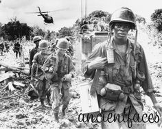 Soldiers walking through the notorious Ho Chi Minh trail in Vietnam during the 1970's