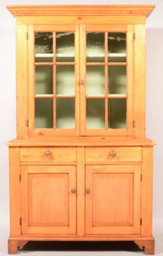 "Sold $950 Pennsylvania Softwood Two Part Dutch Cupboard. Graduated molded cornice, two 6 pane glazed upper doors and chamfered corners. Lower section has two split dovetailed drawers, two lower sunken panel doors, chamfered corners and molded base with bracket feet. Good small size. 76""h x 46-1/2""w x 20""d. Condition: Good with usual wear, professionally refinished."