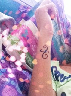 My Pisces tattoo on the side of my wrist my Second favorite tattoo :)