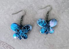 "Iridescent Blue Butterfly"" earrings"