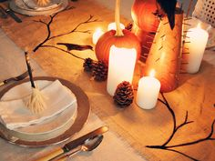 Add a rustic touch to your Halloween table setting with a burlap runner decorated with ghostly bare branches and ravens.