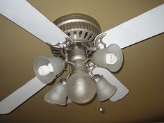 Spray paint the ceiling fans and replace globes