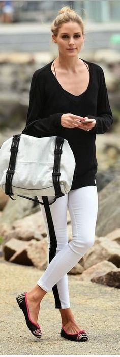 Who made Olivia Palermos white skinny jeans, black tank top, handbag, and zebra print ballet flat shoes?