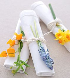 For a pop of color and natural fragrance, tie napkins with twine and tuck in delicate spring blossoms