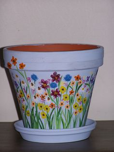 Hand Painted terra cotta pot by scillyface, via Flickr