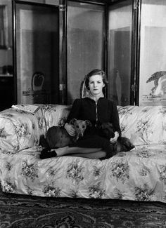 The Hon. Deborah Mitford and dogs in 1938. She became The Duchess Of Devonshire and is now The Dowager Duchess.
