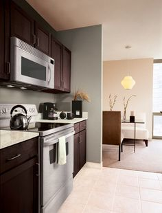 Dark cabinets and a built-in microwave make a kitchen look really classy....