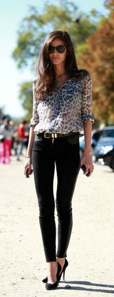 Could be business casual attire. Printed leopard top. Black bottoms.