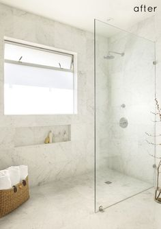 Walk in marble shower with partial frameless glass wall.