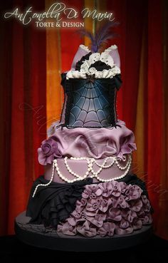 Purple and black Gothic burlesque wedding cake..... Not my style with the goth look.... But this in white with blue and gold accents..... Hmmmm lol gold weddings, black weddings, wedding ideas, gothic wedding, burlesque, wedding cakes, goth wedding, wedding planners, halloween cakes
