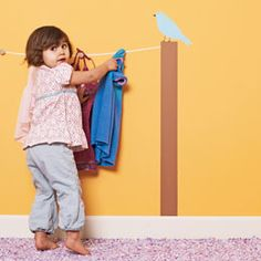 kids room idea- a painted clothes line with hooks for hanging things up ....cute!