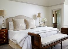 Love the monogrammed, pleated trim pillows.