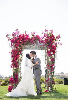 Fuchsia bougainvillea pop against a clear blue sky | Brides.com