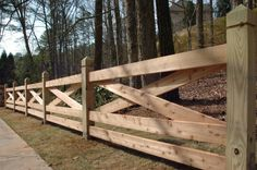 cris cross wooden fence idea