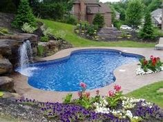Small backyard pool with #waterfall.