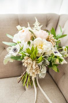 Cream bouquet with anemones | Photography: Je Taime Beauty - www.jetaimebeauty.com  Read More: http://www.stylemepretty.com/little-black-book-blog/2014/05/28/boudoir-bridal-shower-inspiration/