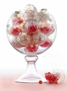 Great centrepiece idea - glass/plastic bubbles filled with shimmer glitter in a glass vase