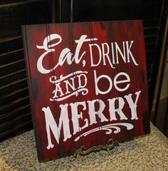 EAT DRINK and be MERRY Sign/Christmas Sign/Red/White/Christmas Party Decor. $19.95, via Etsy.